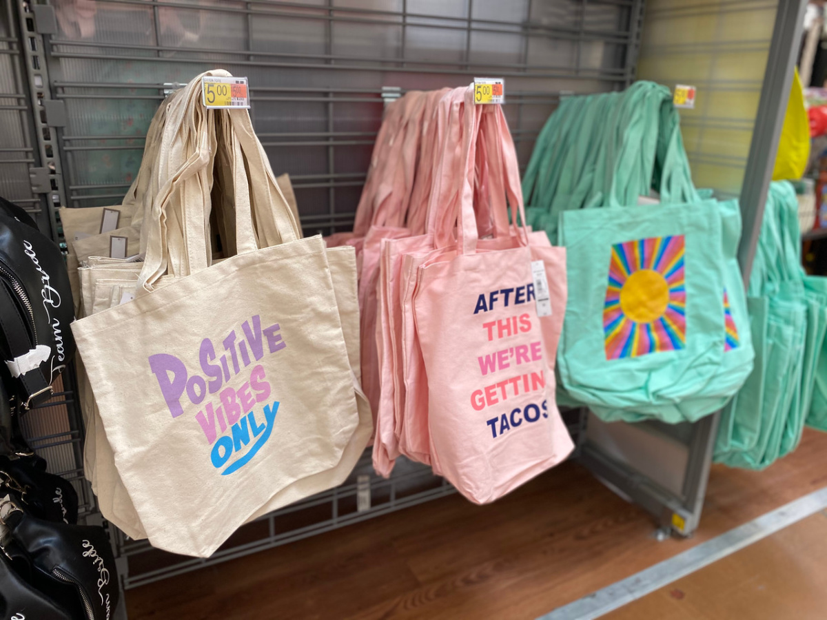 three bags hanging in store on display