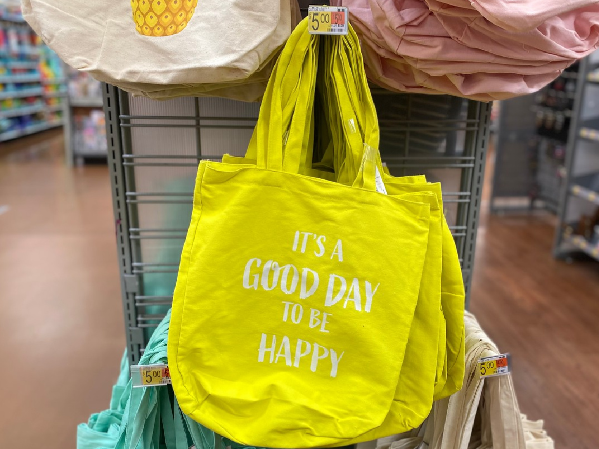 yello tote hanging in store on display