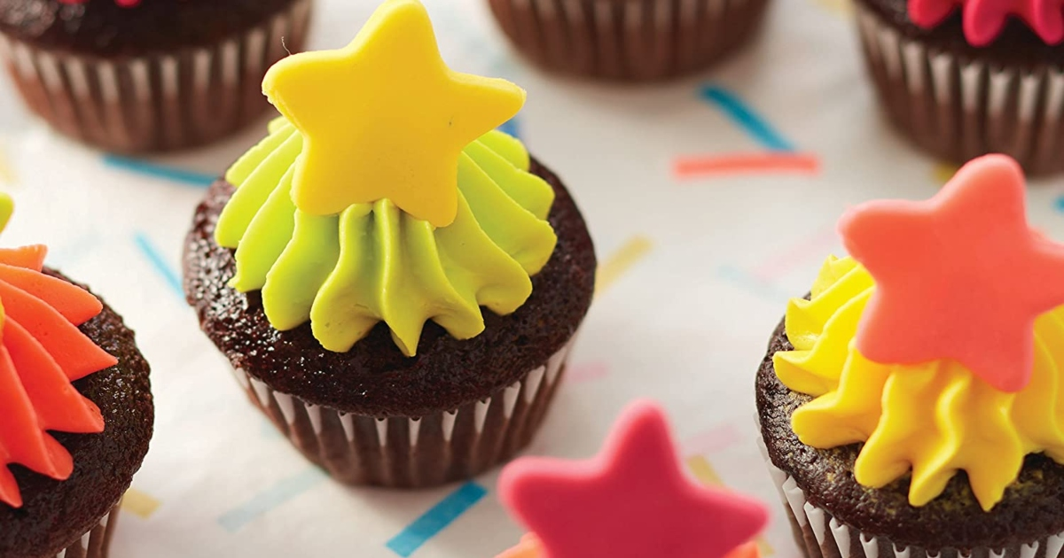 Chocolate cupcakes with icing and stars on top