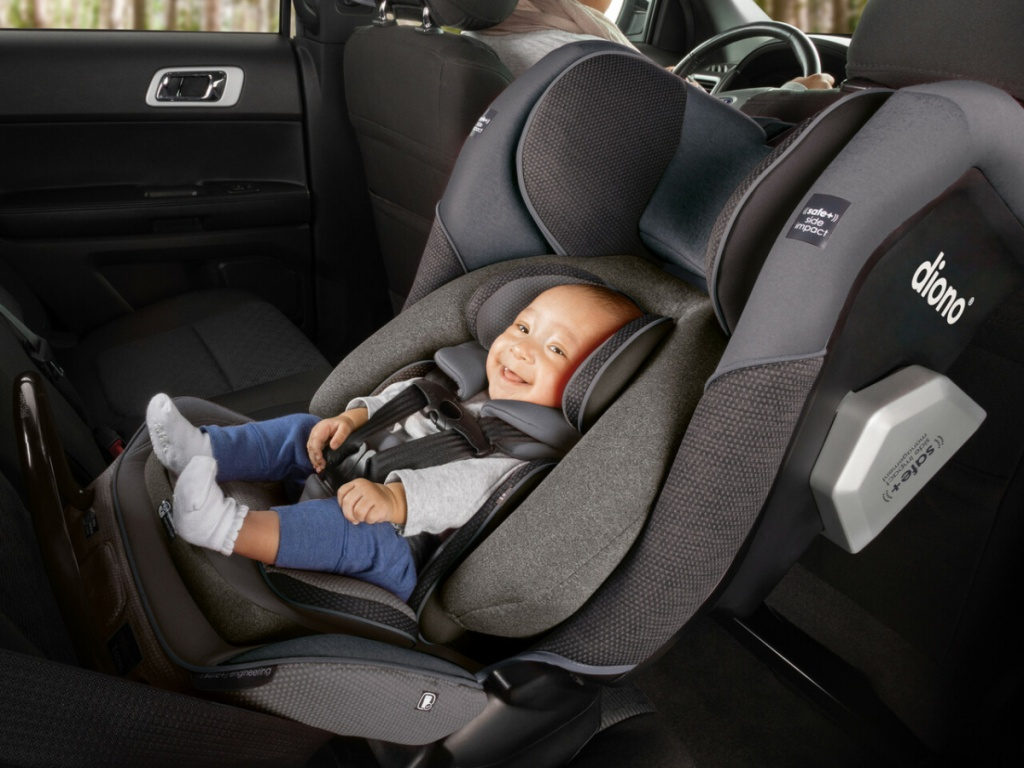 baby sitting in carseat inside car