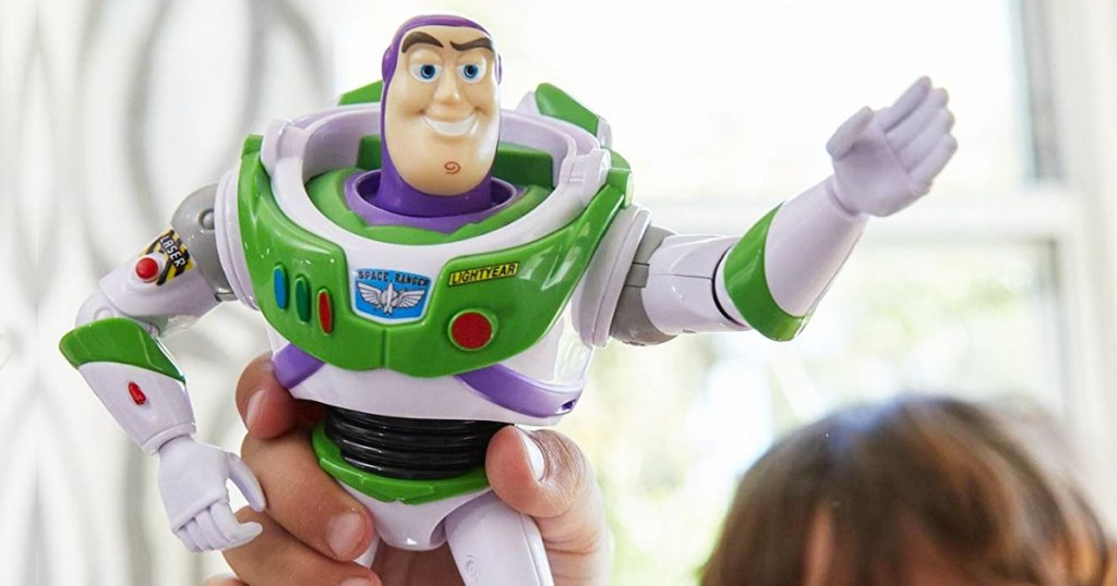 child holding up buzz lightyear action figure in air