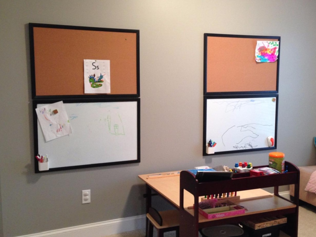 school room with dry erase boards on the walls