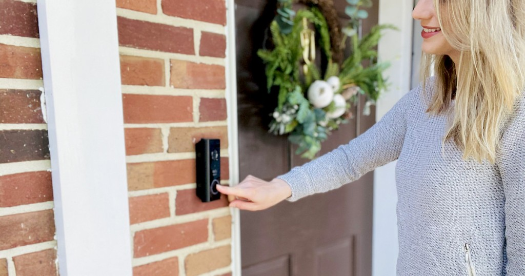 woman pushing on eufy video doorbell