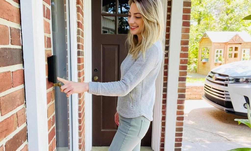 woman pushing on doorbell