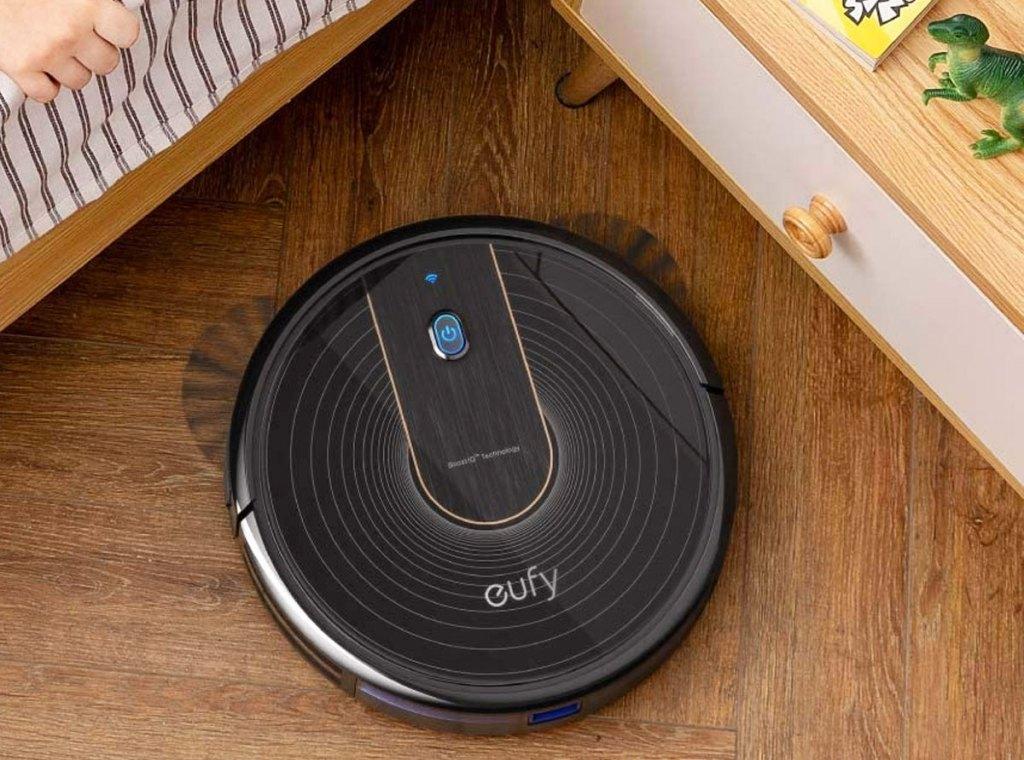 black robotic vacuum on hardwood floor