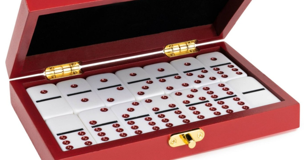 red wooden box filled with dominos