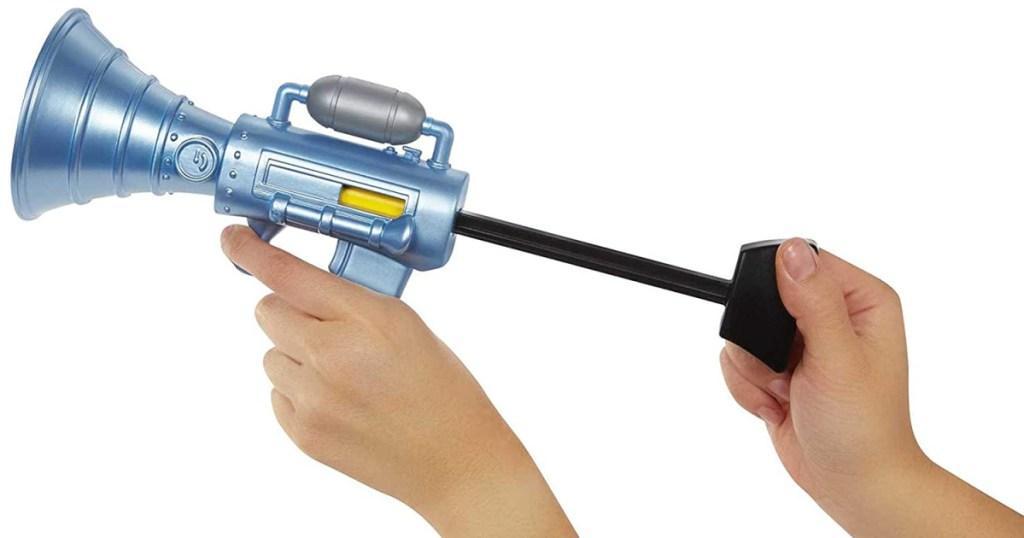 fart gun in hand