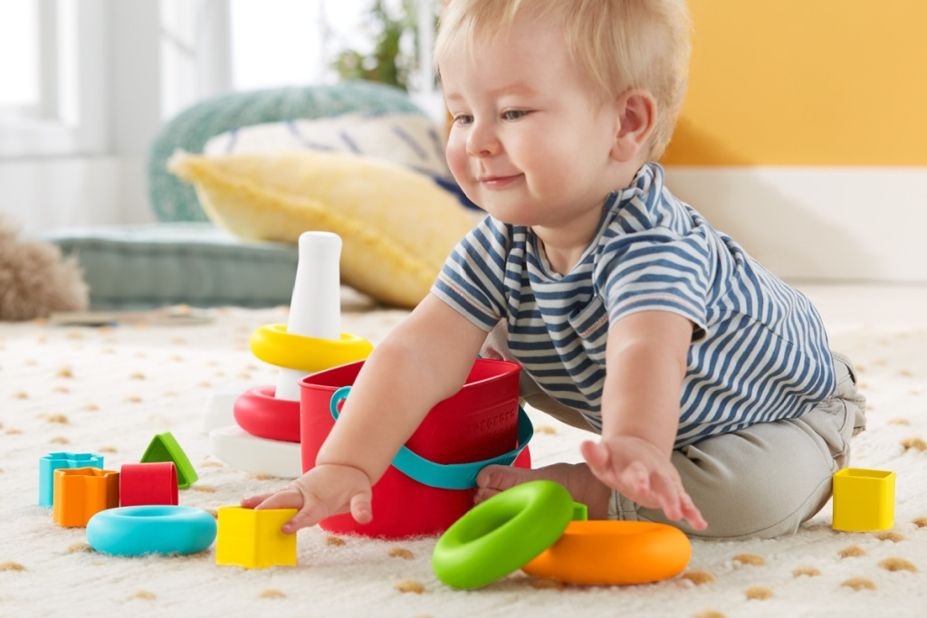 baby playing with fisher price blocks & stack