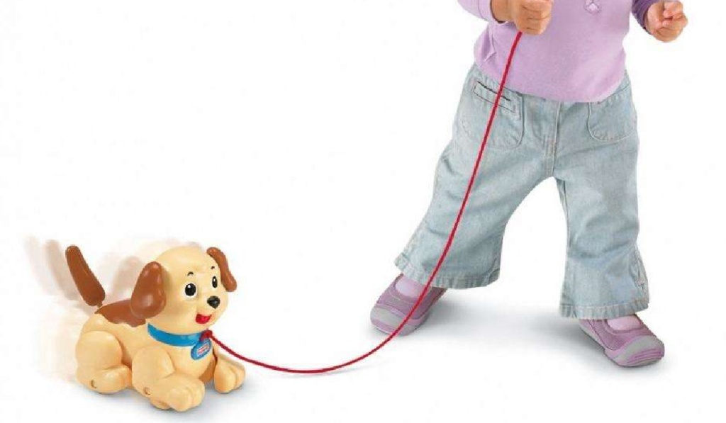 girl pulling fisher price snoopy