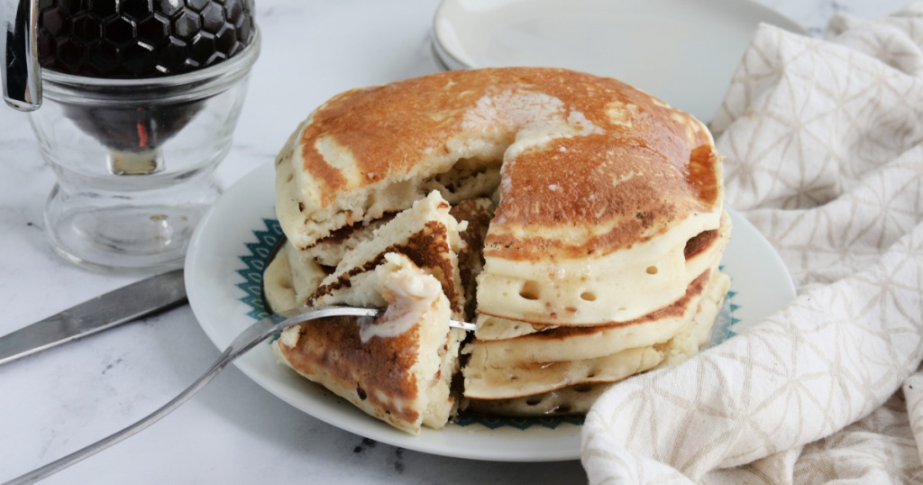 taking a bite of homemade pancakes