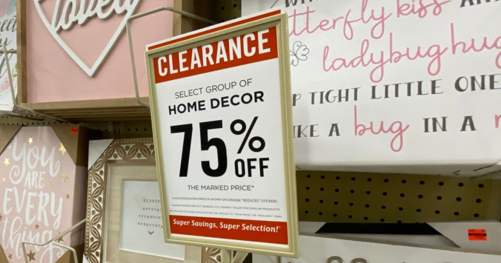 sign with clearance price marked on display in store