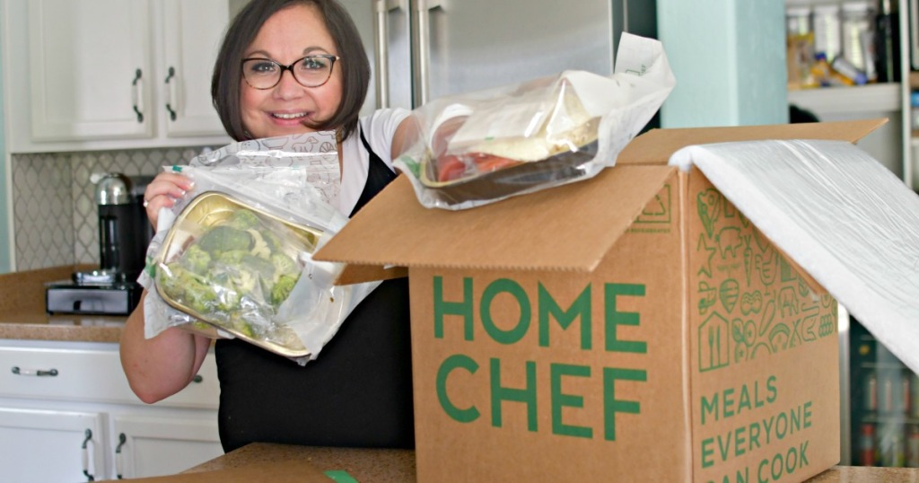 woman taking home chef oven ready meals out of the box