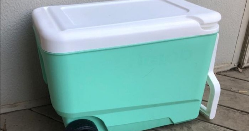mint colored cooler sitting on deck