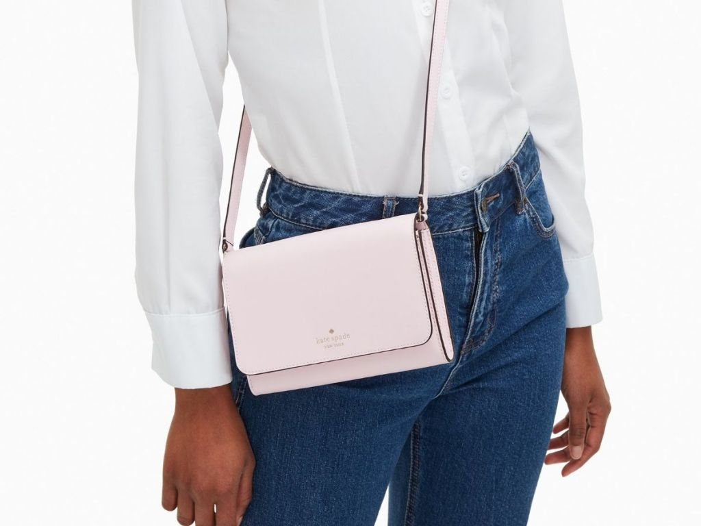 woman wearing pink Kate Spade crossbody
