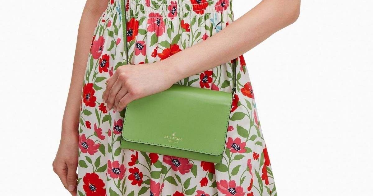 woman in flower dress with green kate spade wallet on a string