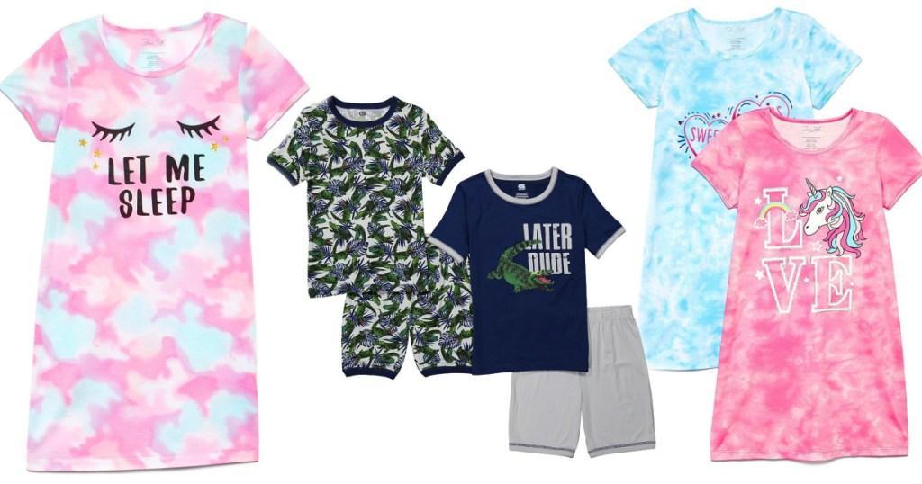 several pairs of kids pajamas on white background