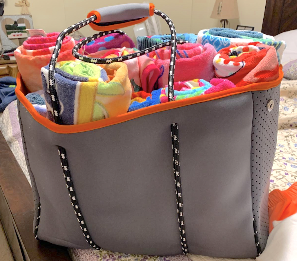 large beach tote filled with towels