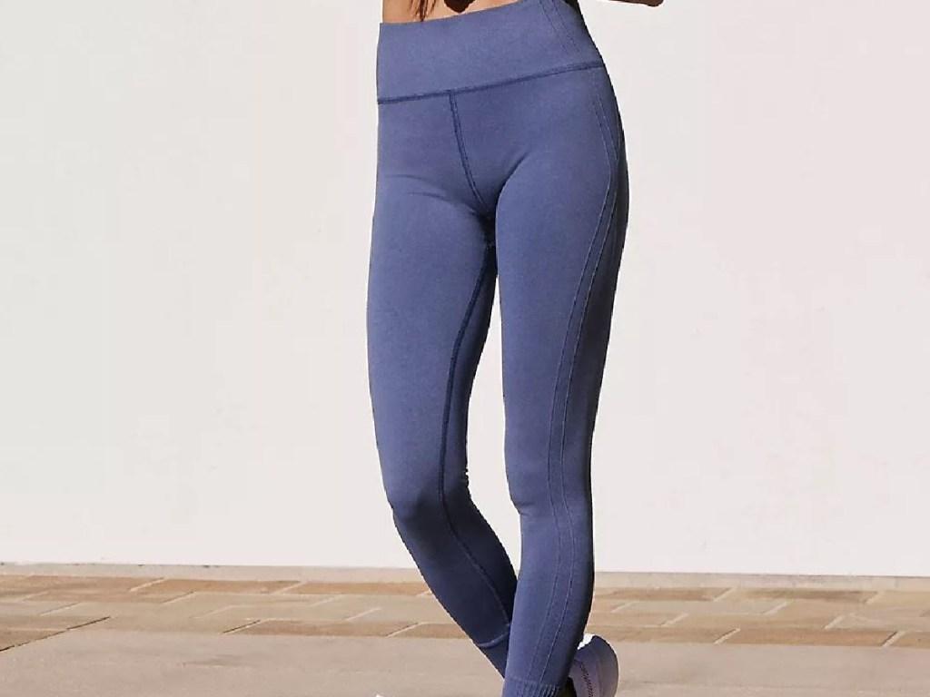 females legs with purple leggings on