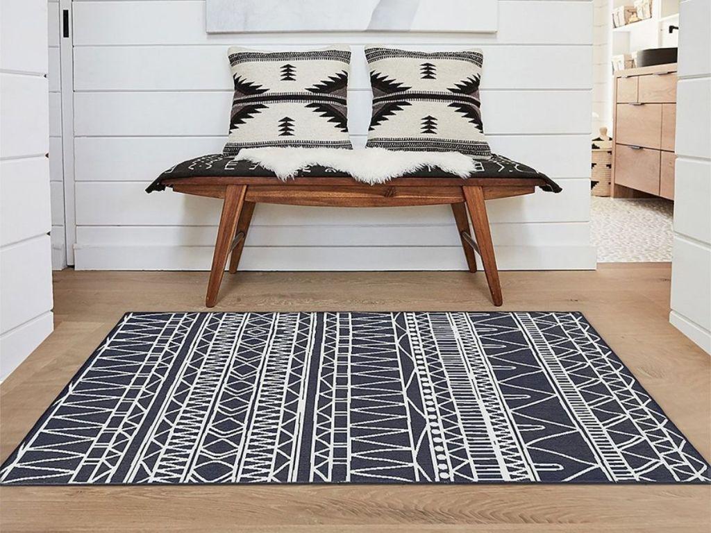 white and black geometric rug