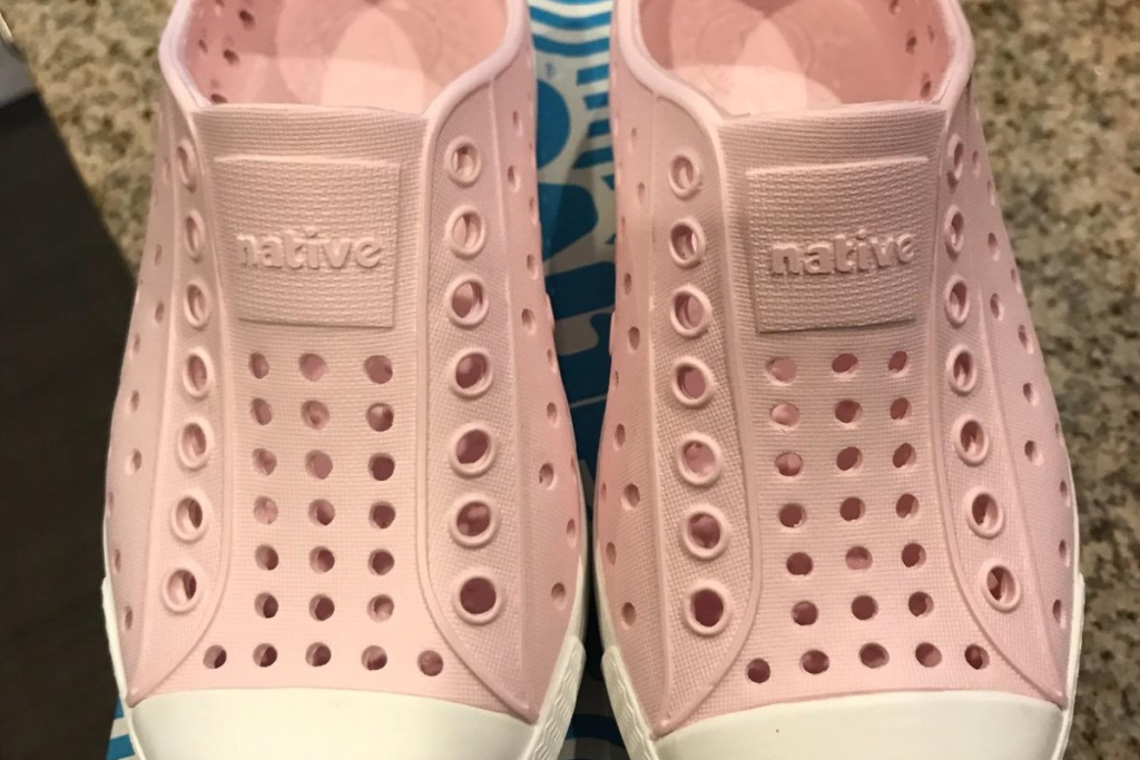 two pink kids water shoes
