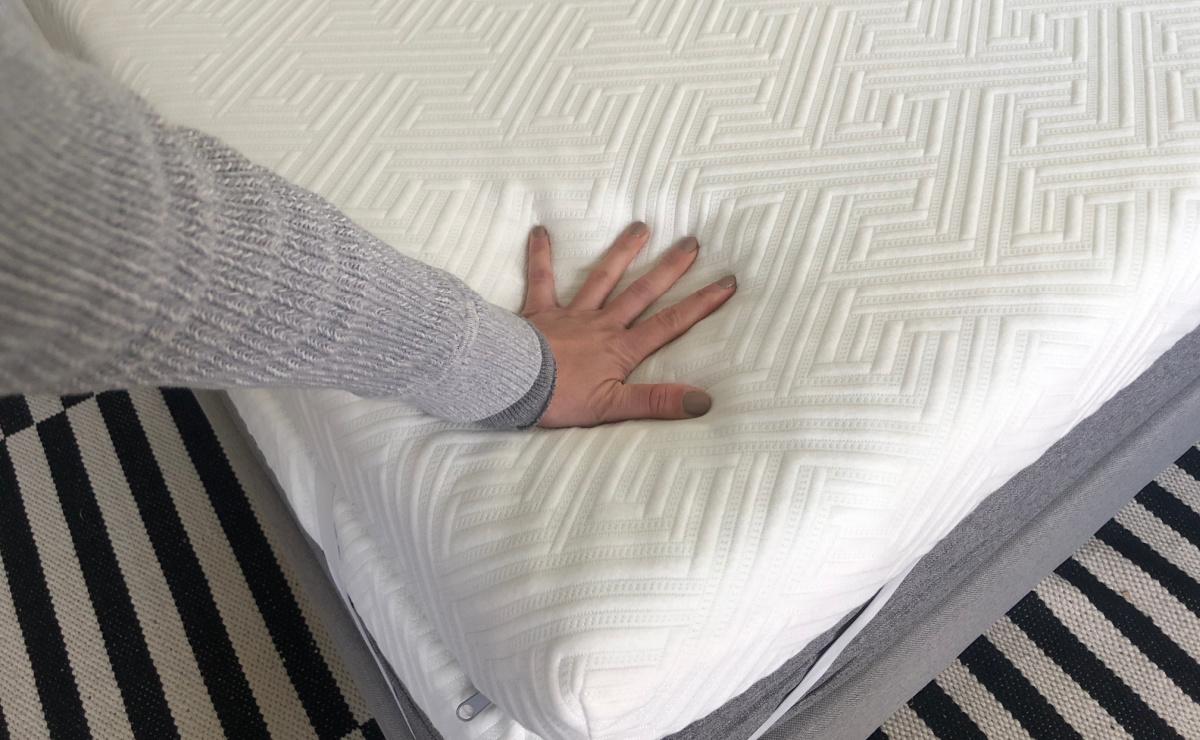 hand touching mattress