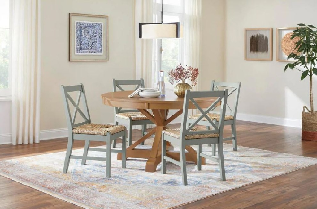 table in kitchen surrounded by chairs