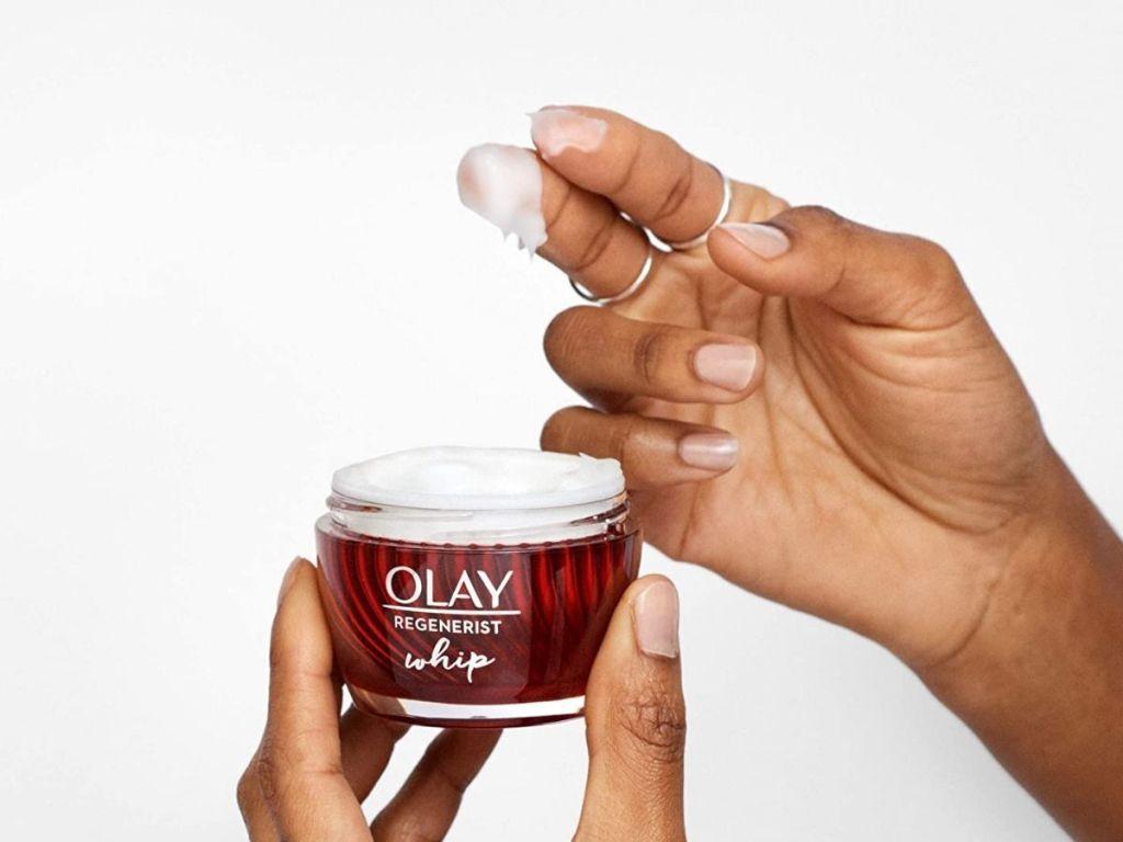 hand holding olay lotion
