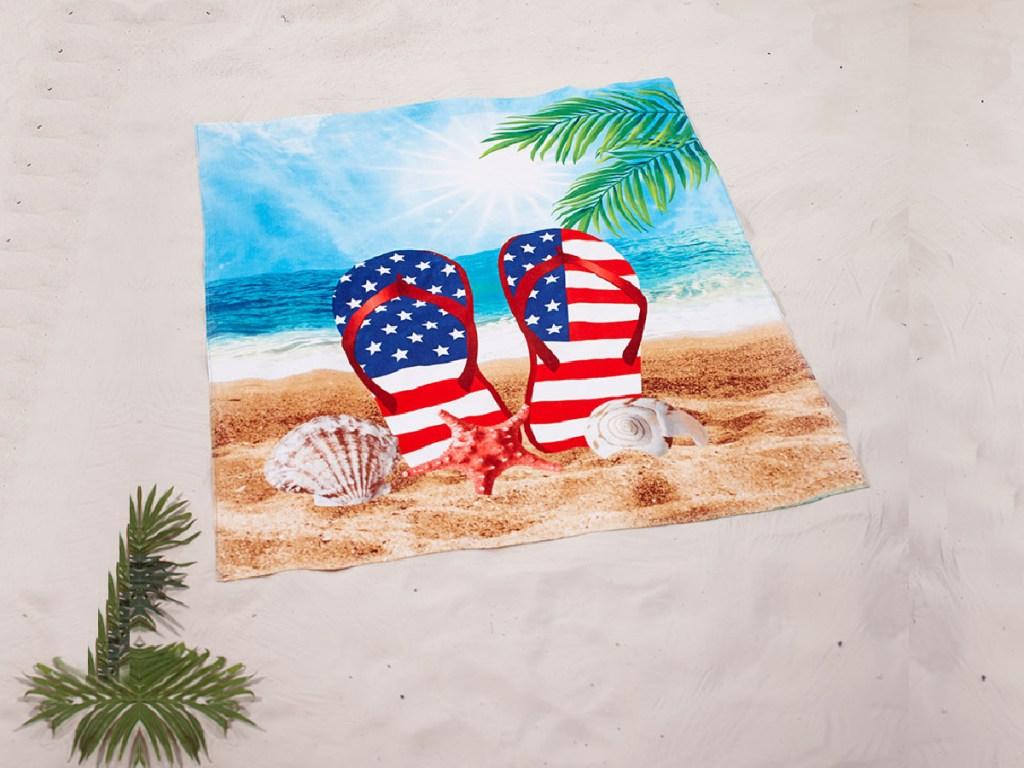 patriotic towel on sand