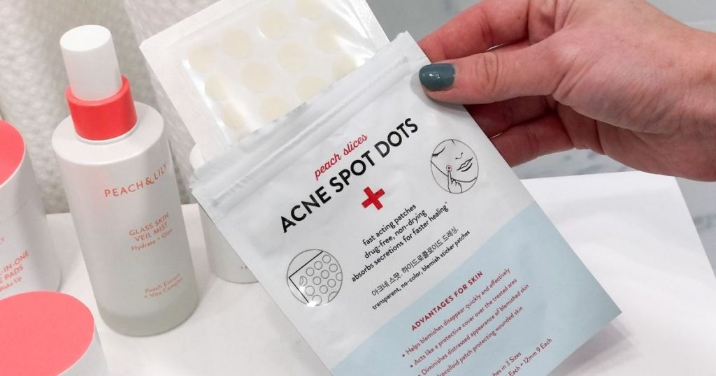hand holding opened Acne Spot Dots packages