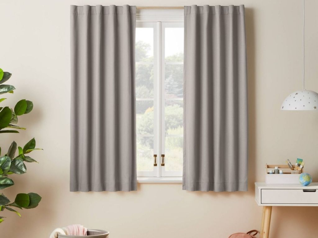 gray curtains hanging in kids room