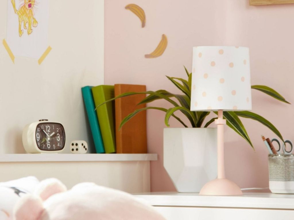 pink and white polka dot lamp in kids room