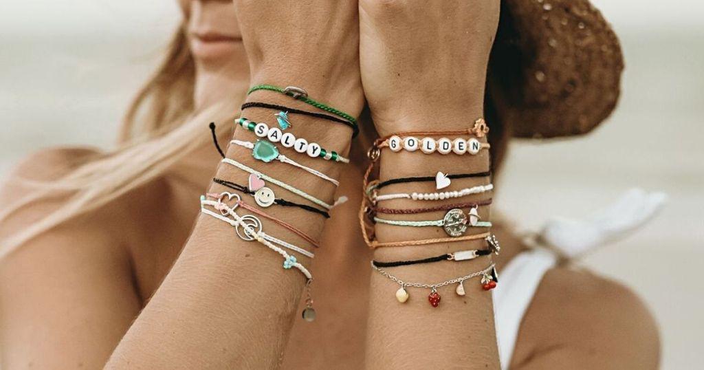 woman wearing lots of bracelets on her wrists