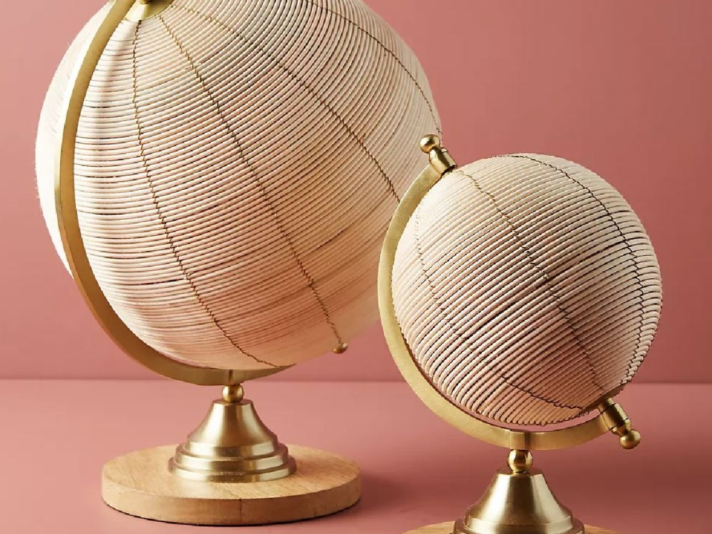 2 globes in gold coloring and made from rattan
