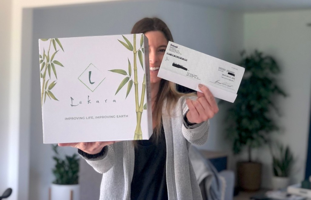 woman holding a large box and check in hand