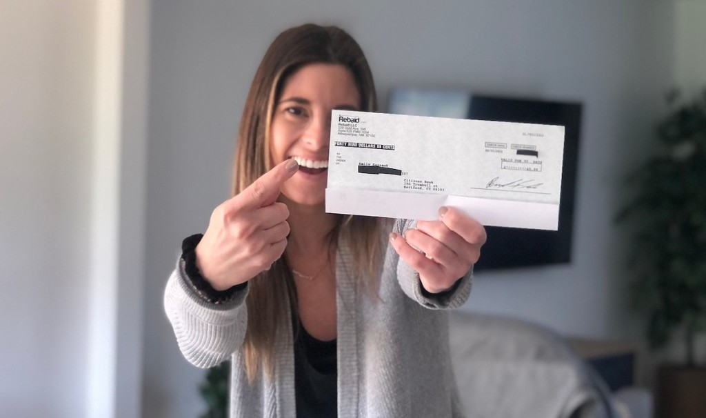 woman holding check in air