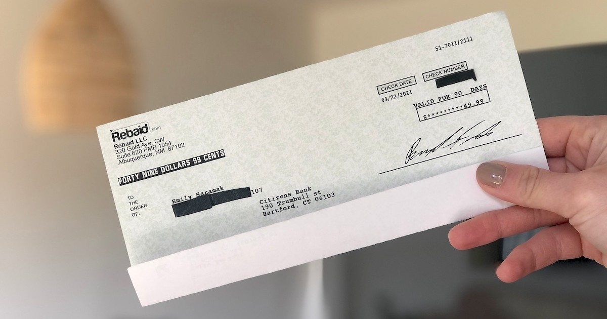 hand holding a check from rebaid, Amazon rebate site
