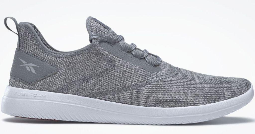 dark gray Reebok walking shoes