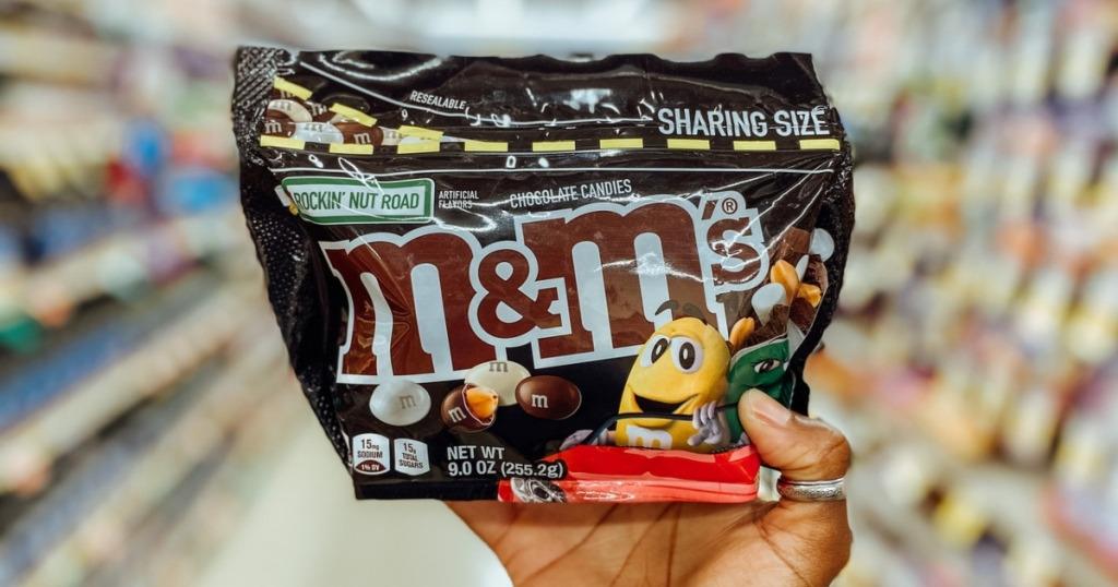 holding a bag of M&Ms