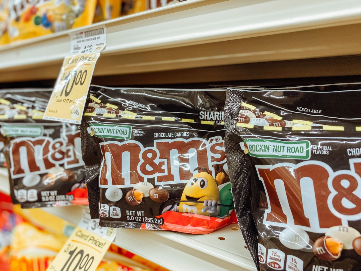 bags of M&Ms on grocery store shelf