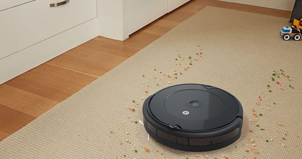 robot vacuum cleaning up debris on carpet
