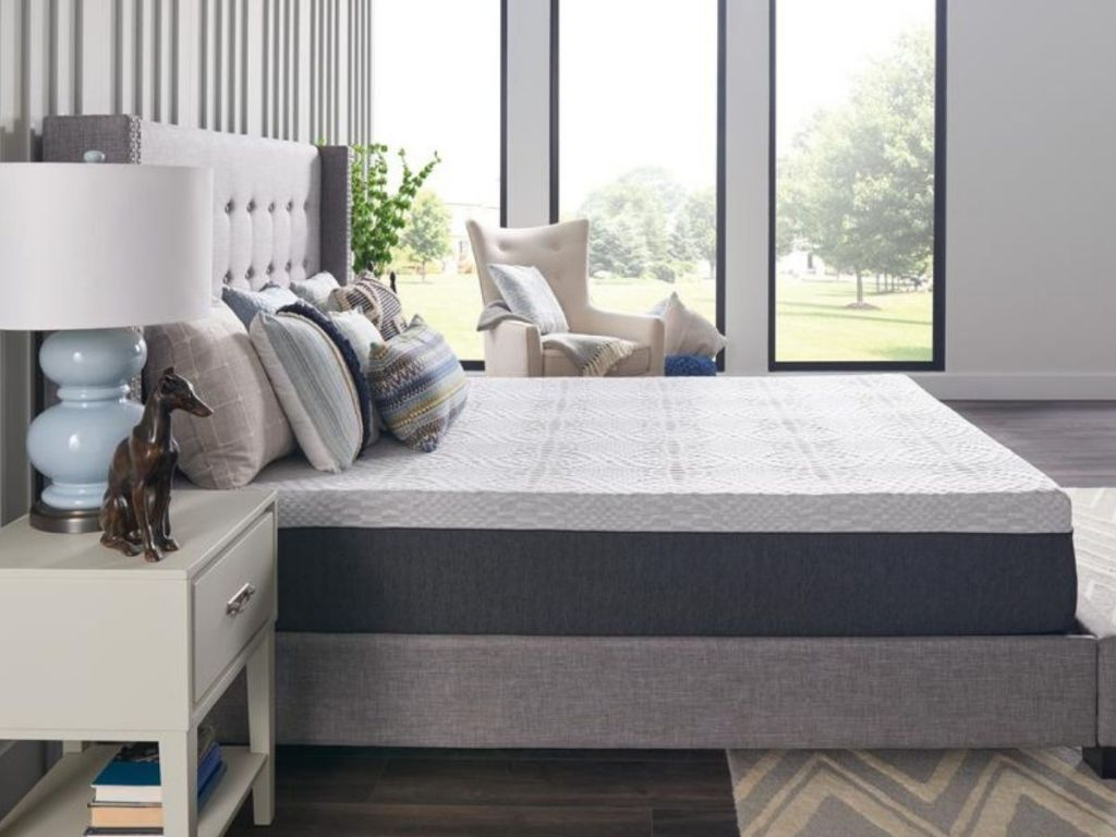 Sealy mattress on bed