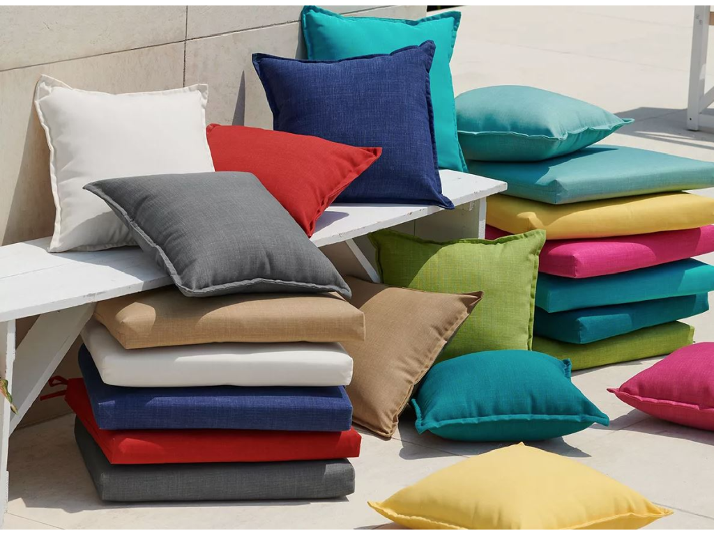 stacks of colorful pillows outdoors