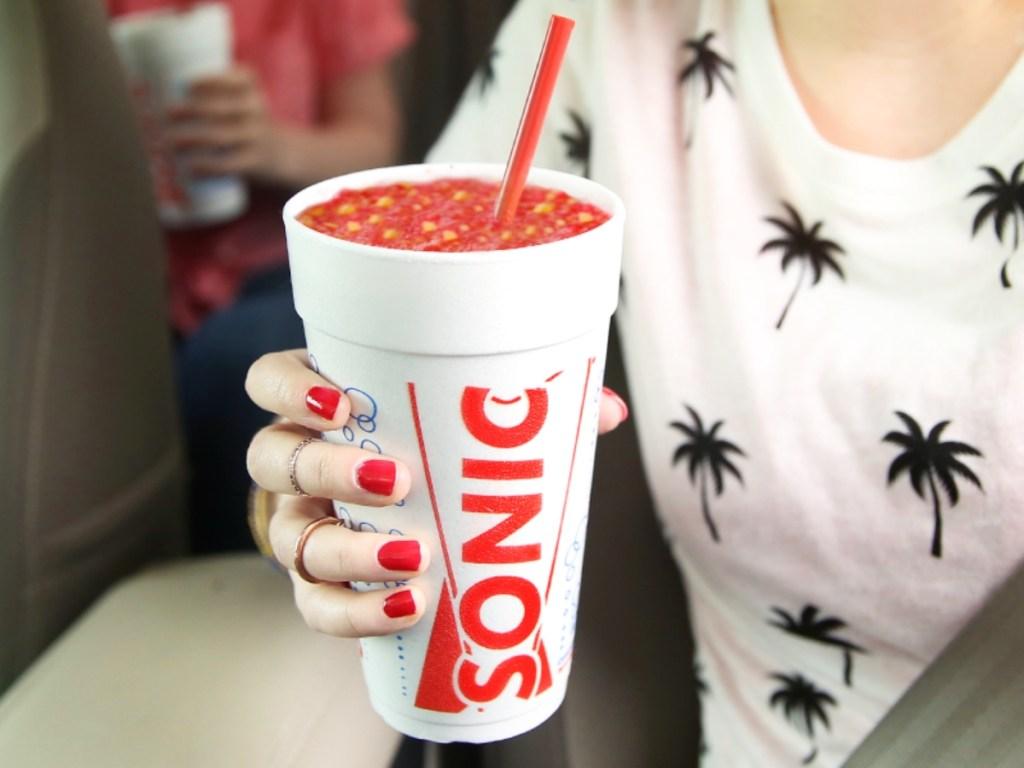 holding a red Sonic slushie