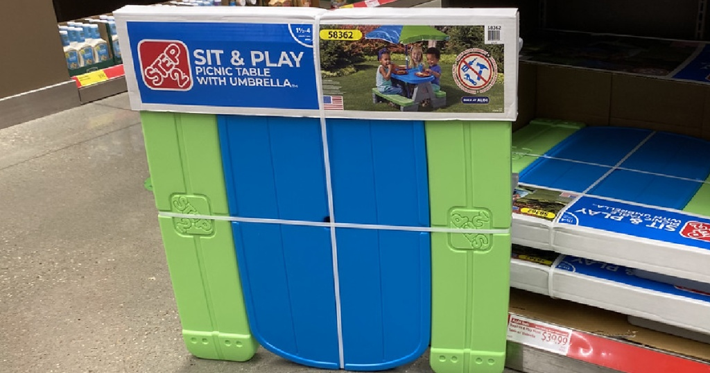 kids blue and green plastic picnic table in box in store