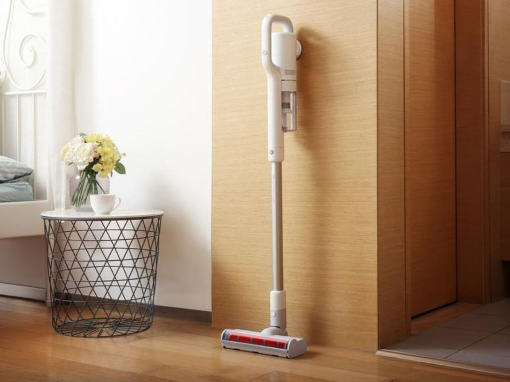 white and red stick vacuum