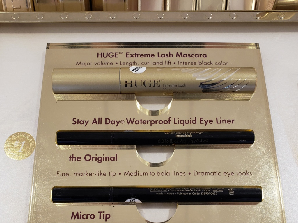 store display with mascara and eye pencils
