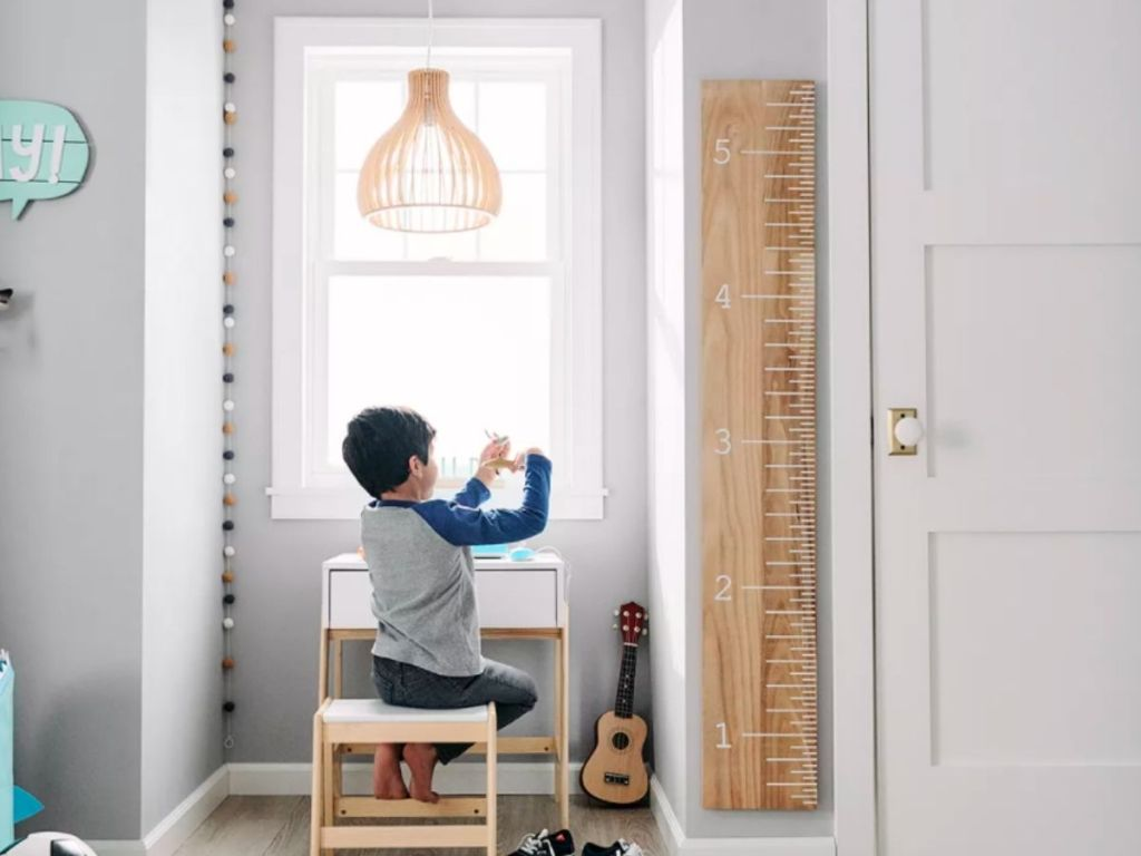 large ruler growth chart on kids bedroom wall