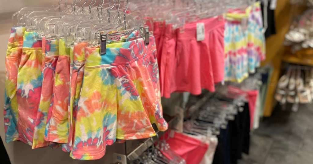 the childrens place skirts on hangers in store
