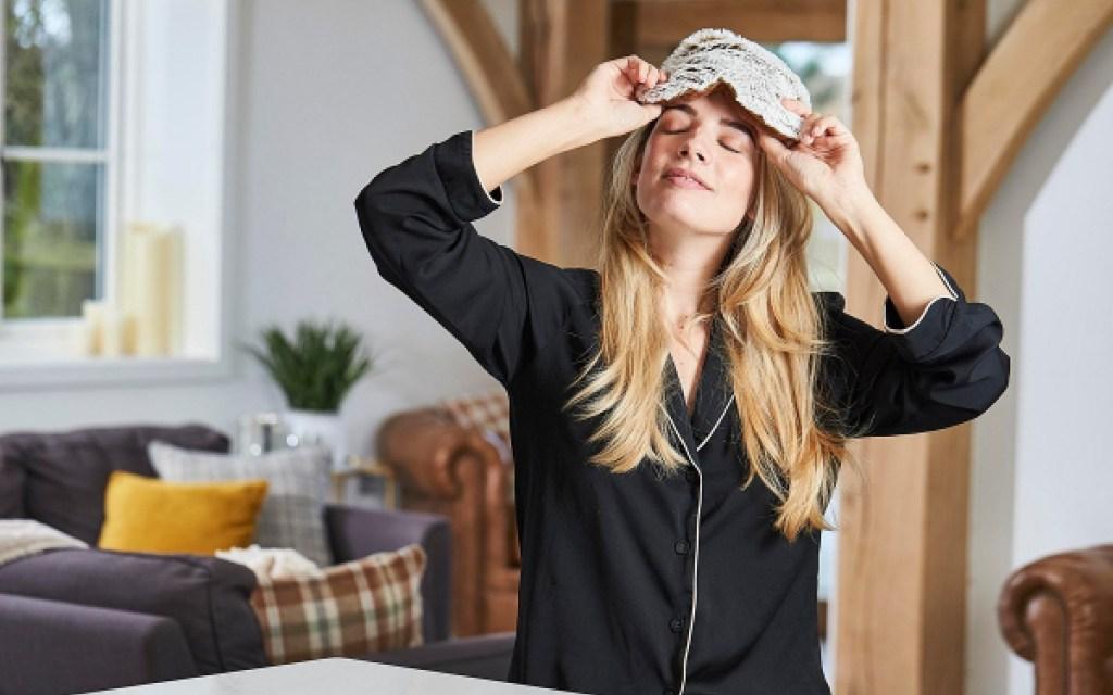 woman wearing warmies eye mask