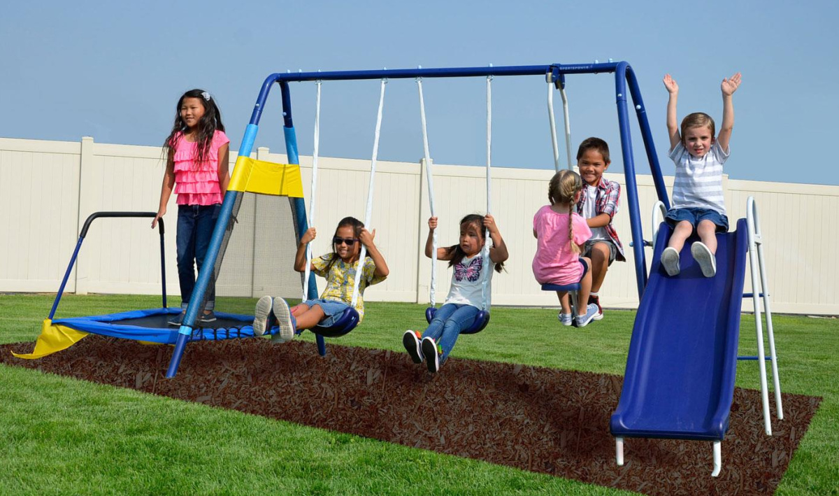 kids playing on blue swingset